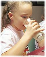 Niña leche