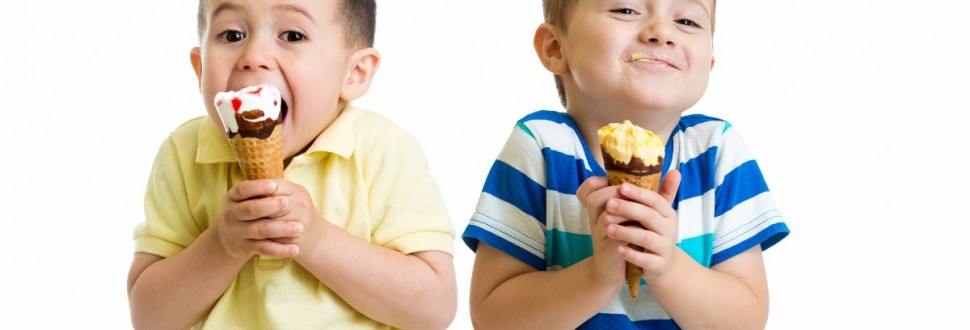 funny children kids little boys eat ice-cream isolated on white